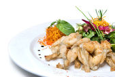 Fried frogs legs on the plate isolated — Stock Photo