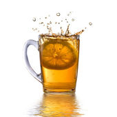 Tea and lemon dropped into cup — Stock Photo