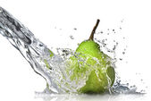 Fresh water splash on green pear — Stock Photo