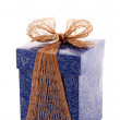 Fancy blue gift box with bronze ribbon - Stock Photo