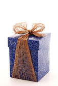 Fancy blue gift box with bronze ribbon — Stock Photo
