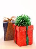 Gift boxes in perspective focus on green — Stock Photo
