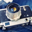 Film rangefinder camera on jeans backgr — Stock Photo