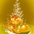 Golden gift-box in front of the xmas tre — Stock Photo #1704657