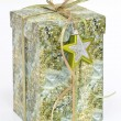 Gift box with star decoration — Stock Photo