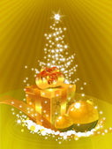 Golden gift-box in front of the xmas tre — Stok fotoğraf