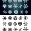 Stock Vector: Set of beautiful snow flakes and stars