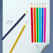 Curled paper sheet with color pencils — Vector de stock