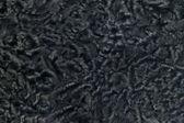 Closeup of black sheepskin fur — Stock Photo