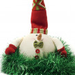 Christmas snowman toy in green tinsel — Stock Photo