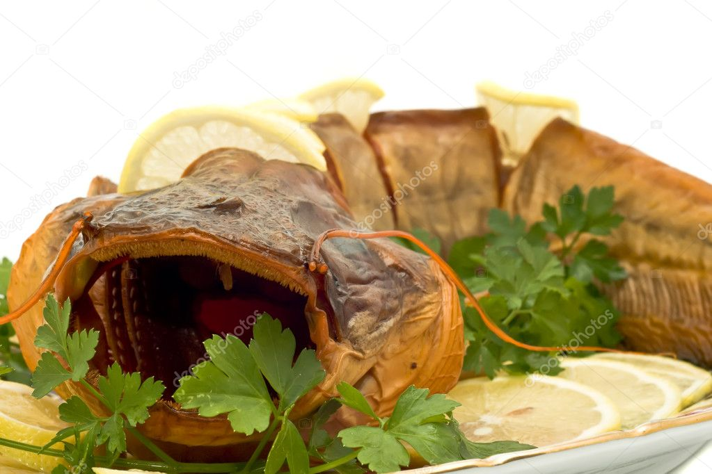 Dinner - fresh-water catfish (sheatfish) with lemon and parsley — Stock Photo #1364378