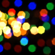 Blurred colorful lights over black — Stock Photo