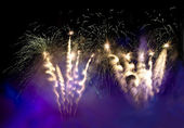 Fireworks in the lilac smoke — Stock Photo