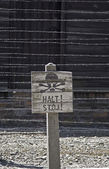 Caution sign board in Auschwitz — Stock Photo
