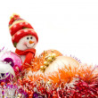 Funny snowman and decoration balls — Stock Photo #1461795