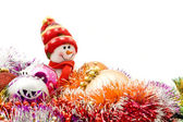 Funny snowman and decoration balls — Stock Photo