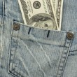 Stock Photo: Money in jeans pocket