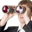 Businessman with binoculars searching - Stock Photo