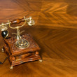 Stock Photo: Old-fashioned telephone on table