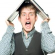 Stock Photo: Shocked mwith laptop over his head