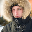 Winter - man in warm jacket with hood — Stockfoto