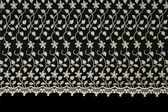 Lacy cloth with flowers pattern — Stock Photo