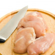 Royalty-Free Stock Photo: Chicken fillet and knife on hardboard isolated