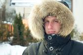 Winter - man in warm jacket with furry hood — Stock Photo