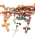 Religion - beads over white — Stock Photo
