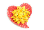 Love - yellow bow on red heart — Stock Photo