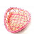 Pink woven basket for gifts on white - Zdjęcie stockowe