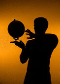 Discover the world - silhouette of man holding g — Stock Photo