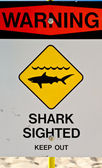 Warning, sharks, sign. — Stock Photo