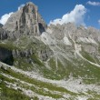 Hiking path in the Dolomites - Stock Photo