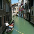 Gondolier at work in Venice. - Stock Photo