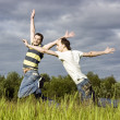 Jumps across the field — Stock Photo