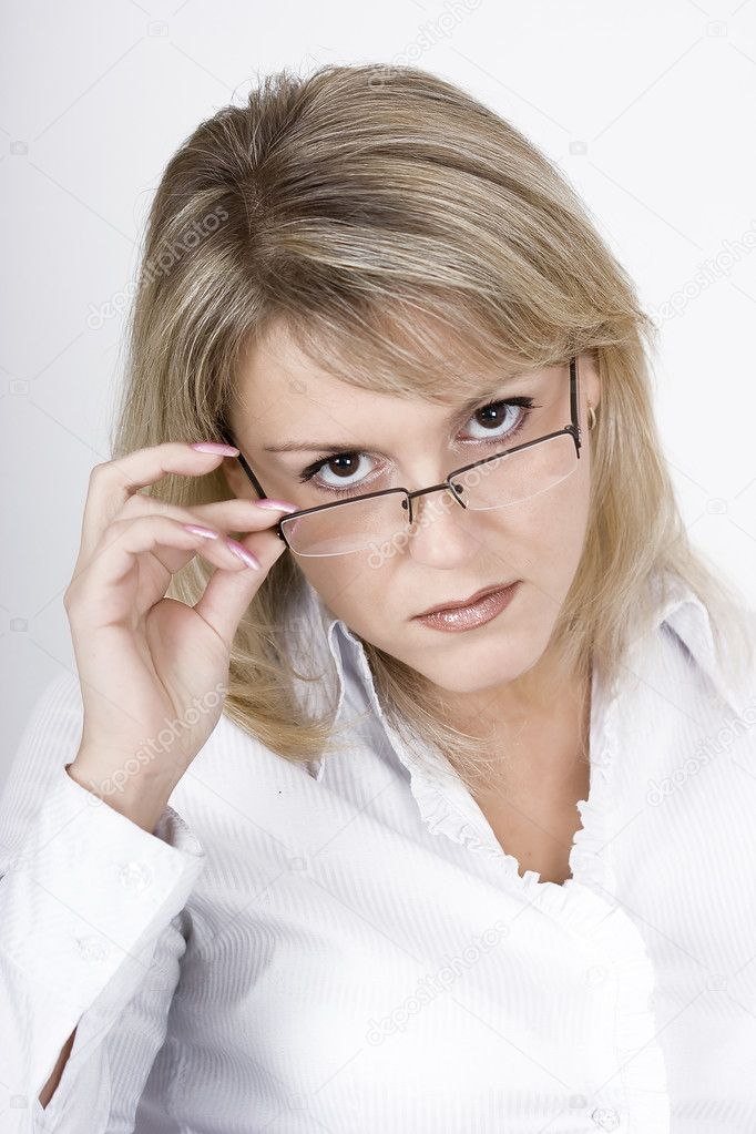 The strict blonde in glasses on a light background — Stock Photo #1478809