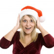 The admired woman in a red Christmas cap — Stock Photo