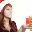 The girl with a Christmas gift — Stock Photo #1488761