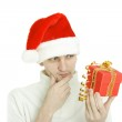 The thoughtful man with gift in hand — Stock Photo #1488799