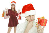 The thoughtful man with gift in hand — Stock Photo