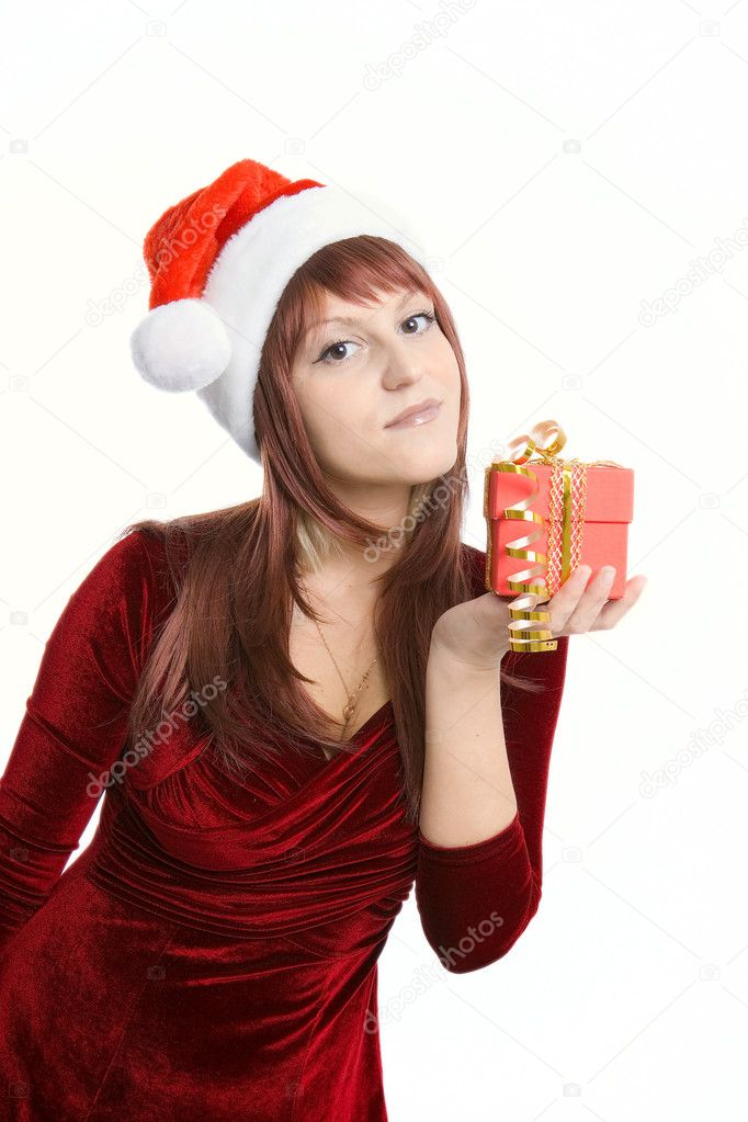 The nice brunette with a Christmas gift in hands — Stock Photo #1488772