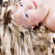Portrait of the blonde on leopard skin — Stock Photo