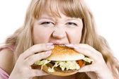 The young woman and hamburger — Stock Photo