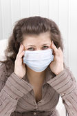 The sick girl with medical mask — Stock Photo