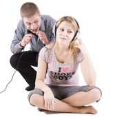 Playful family scene with ear-phones — Stock Photo