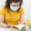 Girl student in a medical mask — Stock Photo