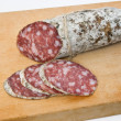 Salami on board — Stock Photo
