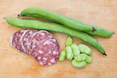 Salami slices and fava bean — Stock Photo