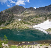 Small alpine lake — Stock Photo